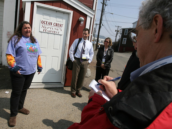 Gloucester: Ann Molloy of Neptune's Harvest explains how they turn by-product from fish processing into fertilizer as a group from the American Planning Association's National Planning Conference tours the Gloucester waterfront yesterday. Photo by Kate Glass/Gloucester Daily Times