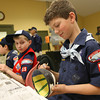 Toby Campbell, a member of Rockport Cub Scout Pack 55, paints a bowl at Open Door on Tuesday night to help prepare for Open Door's Empty Bowl Dinner, which will be held on Thursday, May 12, at Cruiseport. Over 70 people painted bowls with the cub scouts on Tuesday. Photo by Kate Glass/Gloucester Daily Times