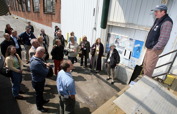 "Gloucester: Scott Memhard, owner of Cape Pond Ice, describes how the business utilizes its location on the waterfront to a group from the American Planning Association's National Planning Conference yesterday. The group toured the Gloucester waterfront as part of a ""Sustaining and Strengthening the Working Waterfront"" mobile workshop. Photo by Kate Glass/Gloucester Daily Times"