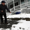 Gloucester: Chuck Karvelas clears snow from the sidewalk in front of his Beacon Street home yesterday morning for what he hopes will be the last time this year. Photo by Kate Glass/Gloucester Daily Times