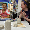 Gloucester: Taylor Abbott, left, and Kashlyn Carrigan giggle as they make mugs at Cape Ann Art Haven to give to their mothers for Mothers Day. They will be glazing the mugs on Friday. Photo by Kate Glass/Gloucester Daily Times