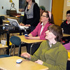 "Rockport: Henry Meredith, an eighth grade student at Rockport Middle School, answers a question while playing ""Are You Smarter than an  Eighth-Grader?"" using new classroom technology at the Middle School Expo. Seated in the middle is eighth-grade English teacher Patti Silva and operating the new equipment is Maddie Wnorowski. Some parents slinked away after failing the test. Photo by Gail McCarthy/Gloucester Daily Times"