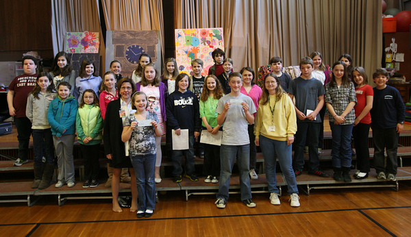 Members of the 5th Grade Leadership Committee at Plum Cove Elementary School presented Beth Graham of Pathways and Nancy Tarbox of Cape Ann Animal Aid with checks totaling $230 during a school assembly on Friday. The students raised the money by paying a quarter to participate in crazy hat day, crazy hair day, sports day, and tropical day during the month of March.