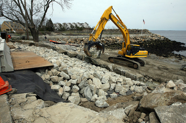 Rockport: John Miller of Miller Golf places a boulder on Back Beach while repairing the beach from erosion caused by a storm in April of 2007. Vine Associates, a division of GZA Geo Environmental Inc., are the engineers for the project, which is funded through FEMA. Photo by Kate Glass/Gloucester Daily Times