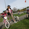Manchester: Gail Coot and her children, Lilly, 7, and Henry, 5, prepare to head home from Manchester Memorial Elementary School with their dog, Annie, yesterday afternoon. This week is Manchester Essex's 6th Annual Walk/Bike To School Week. Photo by Kate Glass/Gloucester Daily Times