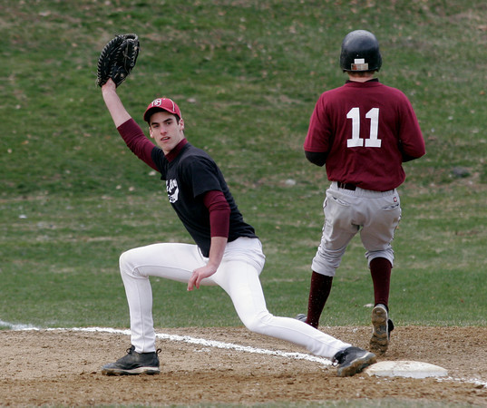 Gloucester: Gloucester first baseman Adam Philpott looks for the call as Rockport's Jay Fulmer is called out during a scrimmage at Evans Field yesterday. Photo by Kate Glass/Gloucester Daily Times