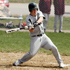 DAVID LE. Gloucester Times. Manchester-Essex batter Corey McColloum (9) fouls away a pitch from the Mystic Valley starter in their game on Friday morning. 4/22/11.<br /> , DAVID LE. Gloucester Times. Manchester-Essex batter Corey McColloum (9) fouls away a pitch from the Mystic Valley starter in their game on Friday morning. 4/22/11.