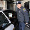 Gloucester Police Officer Scott Duffany shows how the Automated License Plate Reader imports data into the car's computer. The readers can scan over 1,000 plates per hour at speeds of up to 70 miles per hour. Photo by Kate Glass/Gloucester Daily Times