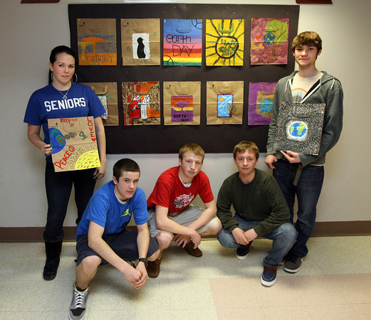 Rockport: Alyssa Albrecht, Dan Glesack, Conor Douglass, Dimitri Baglaneas, and Corey Wrinn, all students at Rockport High School, stand near a display of bags they helped decorate for Shaw's Market to be used on Earth Day, April 22nd. Students from all Rockport schools decorated bags. Photo by Kate Glass/Gloucester Daily Times