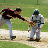 DAVID LE. Gloucester Times. Manchester-Essex baserunner Dom Cirone (2), kneels safely on secondbase as the Mystic Valley shortstop applies the tag with an empty glove during the 3rd inning their matchup on Friday morning. 4/22/11.<br /> , DAVID LE. Gloucester Times. Manchester-Essex baserunner Dom Cirone (2), kneels safely on secondbase as the Mystic Valley shortstop applies the tag with an empty glove during the 3rd inning their matchup on Friday morning. 4/22/11.