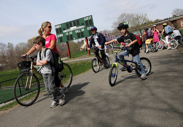 Manchester: Beth O'Grady and her sons, Noah and Mason, lead a portion of the bikers as they head home from Manchester Memorial Elementary School yesterday during the 6th Annual Walk/Bike to School Week, which runs through Friday. Photo by Kate Glass/Gloucester Daily Times