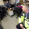 Essex Police Officer Ryan Davis chats with Officers Nick Hamilton, Alex Edwards adn Rob Gilardi in their office on Martin Street during a shift change yesterday. The department is hoping to purchase a modular building for use as a temporary solution to increase office and storage space. Photo by Kate Glass/Gloucester Daily Times