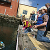 Congressman John Tierney watches as Rockport Middle School student Sayles Kasten launches a remote operated vehicle behind the Gloucester Maritime Heritage Center yesterday morning. Twenty students and two teachers have been learning about the local watershed during a program offered by the heritage center over April vacation. The program is supported through NOAA's BWET program. Photo by Kate Glass/Gloucester Daily Times