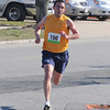 Matthew Veiga of Lynn heads to the finish with a time of 4:58 traking 1st place in the mens 1 Mile YuKan Run Road Race sponsored by the Building Center Saturday morning at Stage Fort Park.Portions of race proceeds help support The Open Door Food Pantry. Desi Smith/Gloucester Daily Times. April 9,2011.