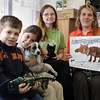 DAVID LE. Gloucester Times. Matt Fuller, 7, and Hiassa Scherr, also 7, of Pathways for Children, hold leashes and a puppy while Cape Ann Animal Aid PR Coordinator Nancy Tarbox holds a kitten, and Executive Director of Cape Ann Animal Aid, Sunniva Buck holds up some drawings the children did. Pathways for Children donated leftover leashes from a fundraiser they held two years ago to the Cape Ann Animal Aid to use. 4/22/11.