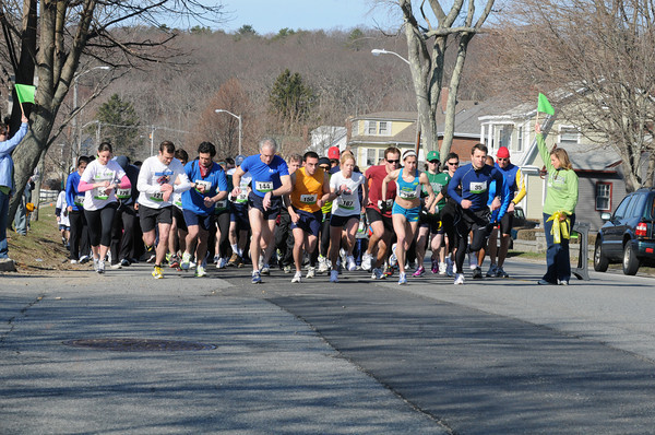 Runners check their watches as they take off for the 1 Mile YuKan Run Road Race sponsored by the Building Center Saturday morning at Stage Fort Park.Portions of race proceeds help support The Open Door Food Pantry. Desi Smith/Gloucester Daily Times. April 9,2011.