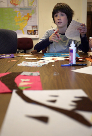 "Gloucester: Corey Baumer cuts fabric for his portion of Eastern Point Day School's ""Westward Ho"" quilt. Each student is making a square for the quilt that includes a piece of the Oregon Trail and the squares will be sewn together into a quilt. Photo by Kate Glass/Gloucester Daily Times"