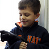 DAVID LE. Gloucester Times. Matt Fuller, 7, of the Pathways for Children program holds a cat that was at the Cape Ann Animal Aid shelter. On Friday Pathways for Children donated leftover leashes from a fundraiser they held two years ago to the Cape Ann Animal Aid to use. 4/22/11.<br /> H, DAVID LE. Gloucester Times. Matt Fuller, 7, of the Pathways for Children program holds a cat that was at the Cape Ann Animal Aid shelter. On Friday Pathways for Children donated leftover leashes from a fundraiser they held two years ago to the Cape Ann Animal Aid to use. 4/22/11.<br /> H