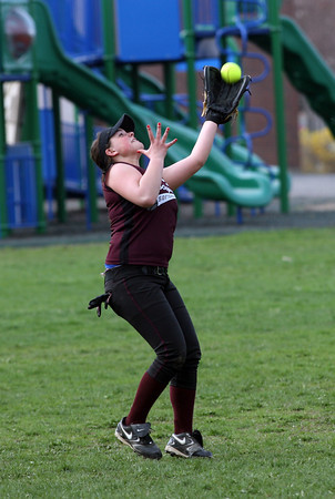 Rockport left fielder Kaylee Stanton reaches for a pop up during their game against Georgetown yesterday. Photo by Kate Glass/Gloucester Daily Times