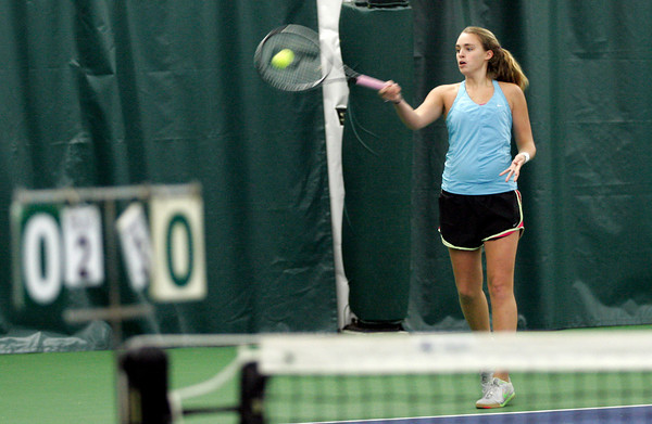 Manchester: Rachel Daley returns a serve during practice at the Manchester Athletic Club. Photo by Kate Glass/Gloucester Daily Times