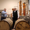 Gloucester: Bob Ryan of Ryan & Wood Inc. Distilleries shows Bob Hastings, executive director of the Cape Ann Chamber of Commerce, the charred new oak barrels that were used to age their first whiskey, Ryan & Wood Straight Rye Whiskey. The Cape Ann Brewing Company then used the barrels to age their Whiskey Barrel Aged Fisherman's Rock-Porter, which will be tapped at the brewery on Friday at 6 p.m. Photo by Kate Glass/Gloucester Daily Times