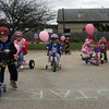 Students at Magic Years Preschool in Manchester participate in a Trike-a-Thon Thursday morning to raise money for the Susan G. Komen Foundation. The school's teachers will be participating in the foundation's 3-Day for the Cure walk in July. The 24 students have helped raise over $1,000 so far and the school is still accepting donations. Photo by Kate Glass/Gloucester Daily Times