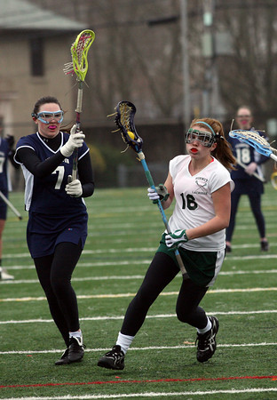 Manchester: Manchester Essex's Vicki Grimes looks for an open shot during their game against Wilmington at Hyland Field yesterday afternoon. The Hornets won 16-9. Photo by Kate Glass/Gloucester Daily Times