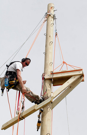 Manchester: Charlie Younger of Project Adventure assembles the platform for the Manchester Athletic Club's new zip line, which will be used primarily for their summer camp programs. Photo by Kate Glass/Gloucester Daily Times