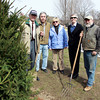 DAVID LE. Gloucester Times. From left, President of Friends of Manchester Trees George Smith, Directors Judi Shipman and Joe Sabella, Director in charge of the Memorial Tree Program, Mimi McDougal, and Jack O'Brien of O'Brien's Landscape and Tree Service, stand next to a freshly planted Norway Spruce tree, just near the exit of the Manchester-Essex Regional High School on Friday morning. 4/22/11.