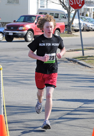 Gloucester: Wyatt Ronan 15,heads to the finish taking 1st place for his age group. Ronan a freshmen at GHS and is a member of the sping track team. He wore his Run for Munn shirt in memory of Coach Jim Munn who passed away this year from brain cancer.Desi Smith/Gloucester Daily Times.April 9,2011.