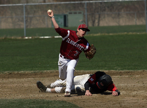 Gloucester: Marblehead's Jake Kulevich slides into Gloucester's Caulin Rogers to prevent him from turning a double play at Nate Ross Field yesterday morning. Photo by Kate Glass/Gloucester Daily Times