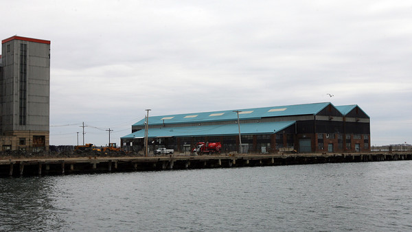 Boston: American Seafood Exchange plans to build a $70 million seafood processing plant, including a public seafood auction, at 3 Dolphin Way in Boston's marine industrial park. There are currently two empty warehouses on the property. Photo by Kate Glass/Gloucester Daily Times