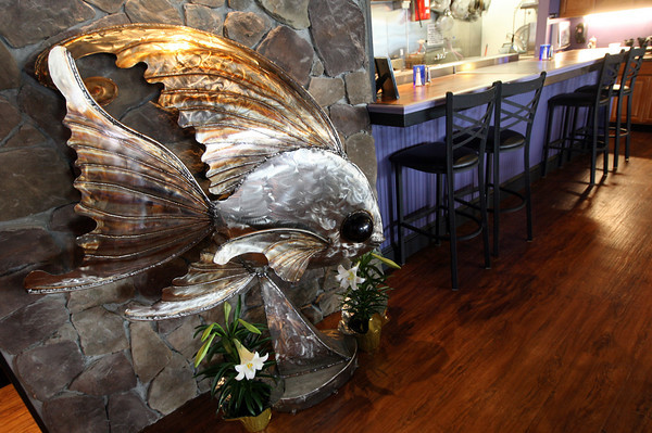 Gloucester: Catch 22 Bistro features an open kitchen and patrons can sit at the bar right and watch as their meal is prepared. Photo by Kate Glass/Gloucester Daily Times