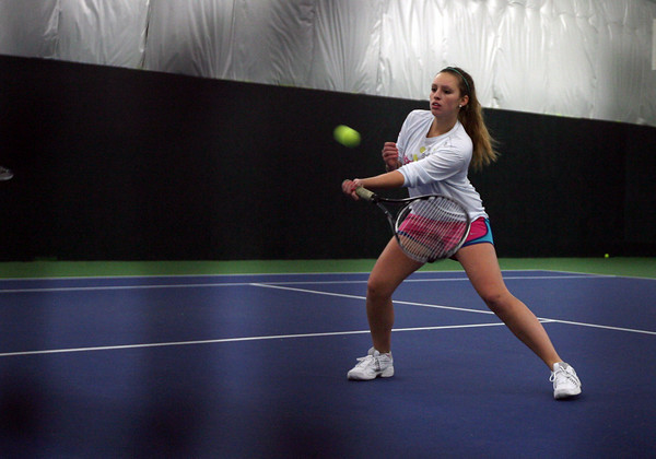Manchester: Hannah Daley, a senior on the Manchester Essex girls tennis team, practices at the Manchester Athletic Club. Photo by Kate Glass/Gloucester Daily Times
