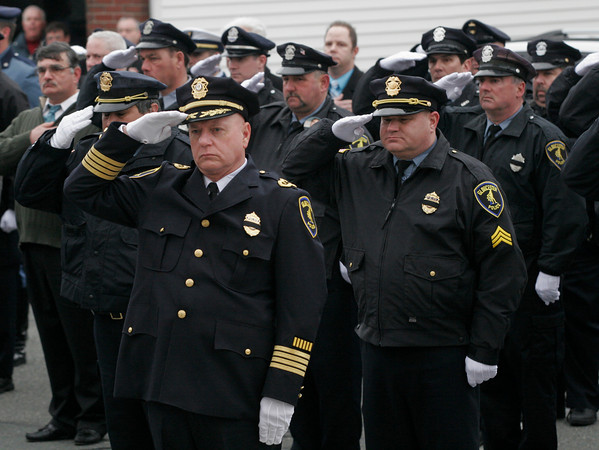 Gloucester: Gloucester Police Chief Michael Lane leads the department in a salute as the casket of Patrolman Steve Amaral is carried up the steps of Our Lady of Good Voyage for his funeral Mass yesterday morning. Amaral, 61, had been a member of the Gloucester Police for 34 years. Photo by Kate Glass/Gloucester Daily Times