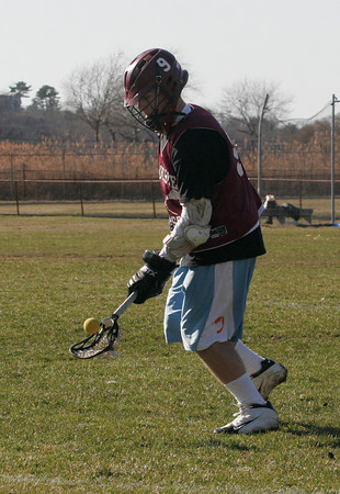 Gloucester captain Geoff Kennedy scoops up a ball during practice yesterday. Photo by Kate Glass/Gloucester Daily Times