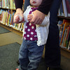 "Manchester: Lila Braier gets some help from her mom, Sarah Pierce-Braier, while doing the motions for the song ""Head, Shoulders, Knees and Toes"" during story hour at the Manchester Library. Photo by Kate Glass/Gloucester Daily Times"