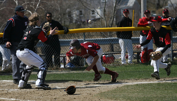 Gloucester: Gloucester's Kyle Lucido gets caught in a pickle coming home during their game against Marblehead at Nate Ross Field yesterday morning. Photo by Kate Glass/Gloucester Daily Times