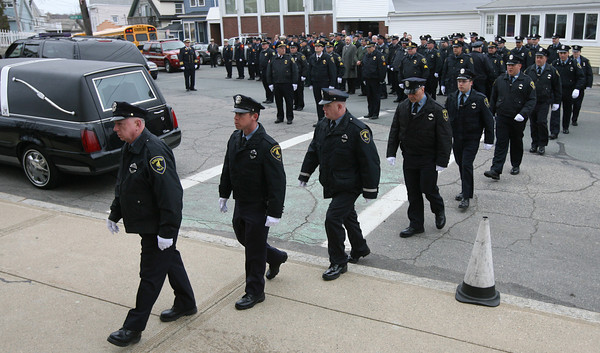 Gloucester: Gloucester Police file up the steps of Our Lady of Good Voyage for the funeral of Patrolman Steve Amaral yesterday morning. Amaral, 61, had been a member of the Gloucester Police for 34 years. Photo by Kate Glass/Gloucester Daily Times
