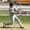 DAVID LE. Gloucester Times. Manchester-Essex's Corey McColloum lines a base hit to left field during the 4th inning of the Hornet's game against Mystic Valley High School on Friday morning. 4/22/11.<br /> , DAVID LE. Gloucester Times. Manchester-Essex's Corey McColloum lines a base hit to left field during the 4th inning of the Hornet's game against Mystic Valley High School on Friday morning. 4/22/11.