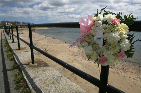 """Gloucester: Brenda Odum, the mother of Jose """"Joe"""" Odum, placed a wreath saying """"my son your home"""" along Stacy Boulevard above where his body was found over the weekend. Odum had been missing since November. Photo by Kate Glass/Gloucester Daily Times"""