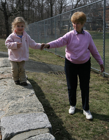 Rockport: Marlin Welcome, 2, holds the hand of her grandmother, Lillian Welcome, while exploring the Story Street playground yesterday afternoon.  Photo by Kate Glass/Gloucester Daily Times