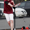 Gloucester: John Perry returns the ball while playing a doubles match with Matt Martin against Beverly at Gloucester High School yesterday. Photo by Kate Glass/Gloucester Daily Times