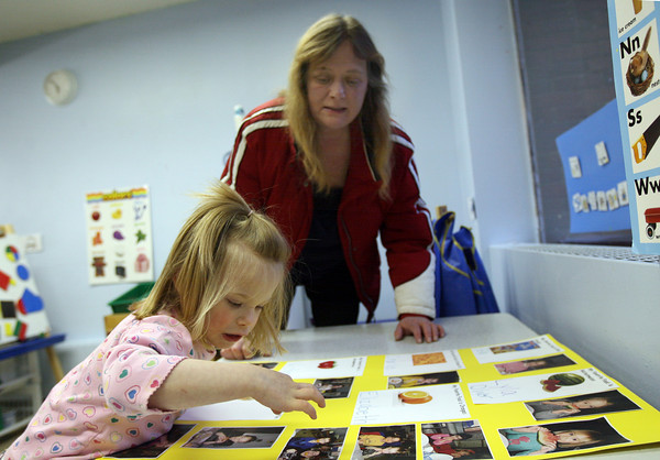 "Gloucester: Deborah Davis watches as her daughter, Nicole Kafka, 3, points out her friends during an open house at the Gloucester Preschool in the Fuller School. ""I hear her sing their names every night,"" Davis says. Photo by Kate Glass/Gloucester Daily Times"