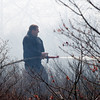 Gloucester: Gloucester Firefighter Dave Lovett puts out a brush fire on Poles Hill yesterday afternoon. Photo by Kate Glass/Gloucester Daily Times