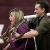 Rockport: Ann Wonson, a 4th-5th grade teacher at Rockport Elementary School screams as Joe from Wildlife Encounters places a carpet python around her neck during an Australian Wildlife program at the school. Photo by Kate Glass/Gloucester Daily Times