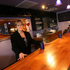 Gloucester: Marcie Lang, manager of Catch 22 Bistro, stands behind the bar of the restaurant, which had a soft opening this weekend. Photo by Kate Glass/Gloucester Daily Times