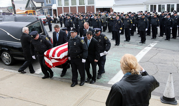 Gloucester: Members of the Gloucester Police and Fire Departments, Rockport Police Department, and State Police salute as the casket of Gloucester Police Officer Steve Amaral is carried up the steps of Our Lady of Good Voyage for his funeral Mass yesterday morning. Amaral, 61, had been a member of the Gloucester Police for 34 years. Photo by Kate Glass/Gloucester Daily Times