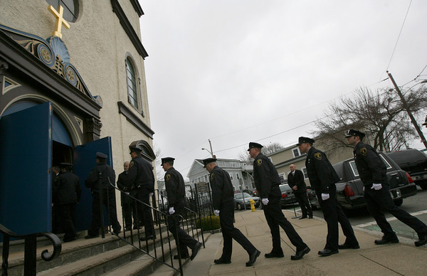 Gloucester: Members of the Gloucester Police Department file into Our Lady of Good Voyage for the funeral Mass of Patrolman Steve Amaral yesterday morning. Amaral, 61, had been a member of the Gloucester Police for 34 years. Photo by Kate Glass/Gloucester Daily Times