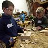 Essex: Paul Wertz and his brother, Will, both of Ipswich, learn basic woodworking techniques at the Essex Shipbuilding Museum as part of their April Vacation program. The two said they were building boats from the wood scraps. Photo by Kate Glass/Gloucester Daily Times<br /> , Essex: Paul Wertz and his brother, Will, both of Ipswich, learn basic woodworking techniques at the Essex Shipbuilding Museum as part of their April Vacation program. The two said they were building boats from the wood scraps. Photo by Kate Glass/Gloucester Daily Times